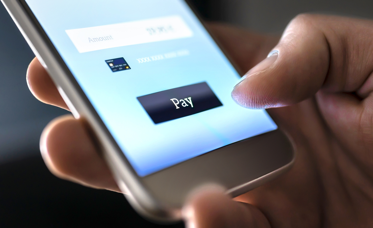 e-commerce payment methods are found on mobile too as seen with this person purchasing via mobile